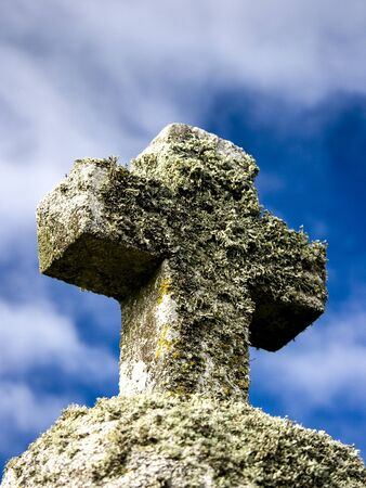 Stone Cross with cloudy sky in the background Stockfoto