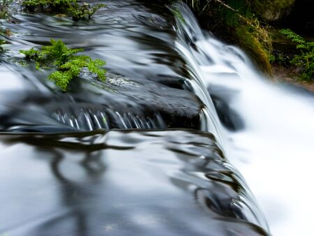 Long exposure waterfall with foam and reflections Stockfoto