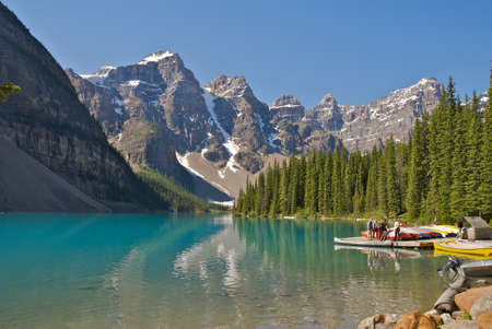 lake flowers: Moraine Lake in Banff National Park and Canoes, AB, Canada