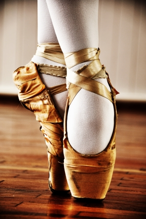 Ballet dancer with old shoes photo