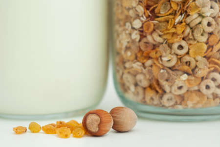 Healthy breakfast with cereals, milk, nuts and raisins  photo