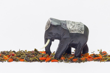 dark elephant tusks with a silver blanket is on the dry tea and red wolfberries photo