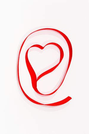 Set as symbolic red heart made of red ribbons  photo