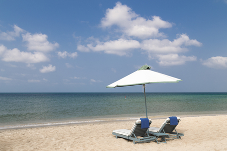 two loungers on the beach with white sand  photo