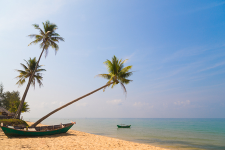 Marine landscape with palm trees, boats and transparent water on Phu Quoc, Vietnam photo