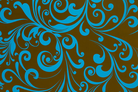 blue pattern with curls on brown background photo