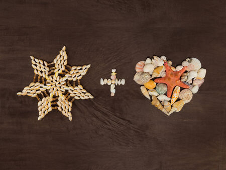star and heart made ​​of small colored shells and the plus sign photo
