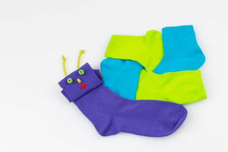 colored socks in the form of a snail on a white background  photo