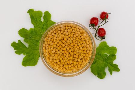 soaked in water, chickpeas, tomatoes and lettuce around on a white background  photo