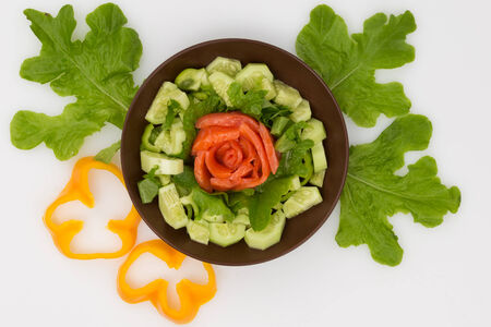 fresh salmon and vegetables salad on white background photo