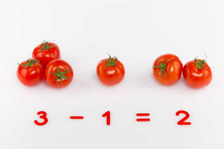 assume: arithmetic example of bright red tomatoes and prime numbers on a white background
