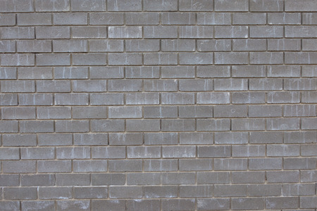precipitation: wall from gray concrete bricks under the influence of precipitation