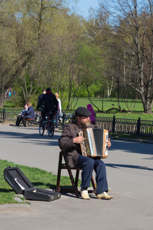 MOSCOW - May 2014: Street musician in the botanical garden in spring, in May 2014, Moscow, Russia