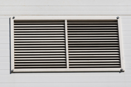 louvered: metal painted gray VENTILATION GRILLS on the facade