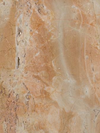 texture beautiful natural marble stone beige-orange photo