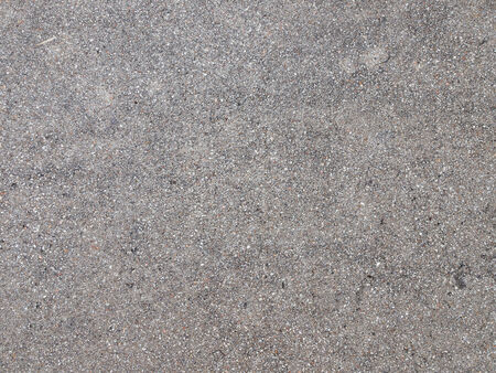 inclusions: gray rough asphalt with small punctate inclusions