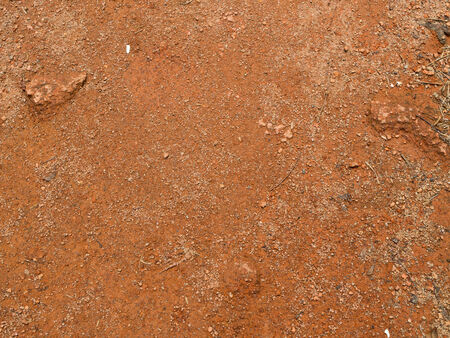 interspersed: uneven bumpy clay soil interspersed with small pebbles