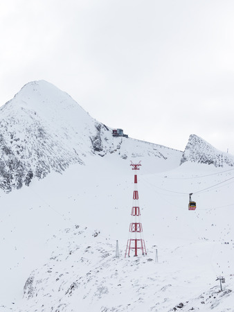 kaprun: Zell am See - Kaprun - December 6, 2014: A lot of people go to the mountain ski resort in the Alps at an altitude of 3000 m on the glacier Kitssteynhorn on a background of white clouds December 6, 2014, Zell am Cee - Kaprun, Austria