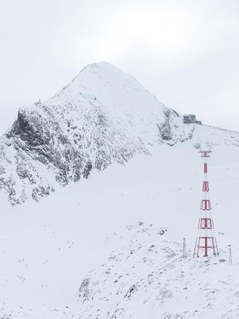 kaprun: Zell am See - Kaprun - December 6, 2014: People have a rest at a ski resort in the Alps at an altitude of 3000 m on the glacier Kitssteynhorn December 6, 2014, Zell am Cee - Kaprun, Austria Editorial