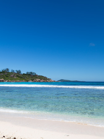 peaceful scene: nice clean beach with clear waters and clear skies