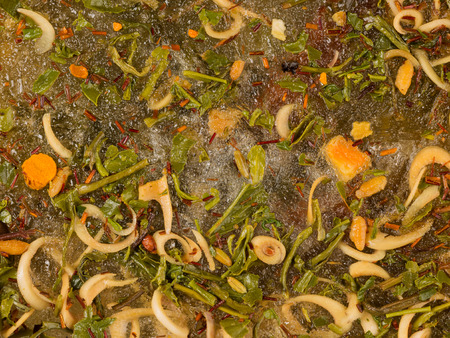 abstraction of a lot of different bright tasty spices and seasonings in water photo