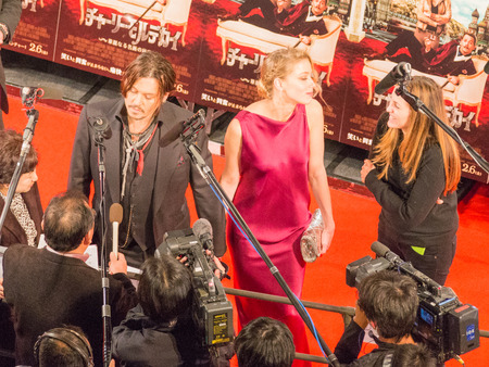 heard: Tokyo - January 27, 2015: Johnny Depp gives interviews and Amber Heard at the presentation of the movie Mordecai and movie posters around January 27, 2015, Tokyo, Japan Editorial