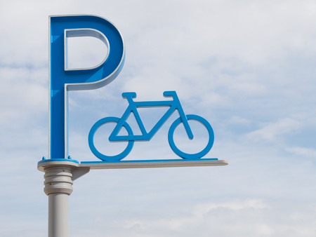 bike parking: big blue bike parking sign with the letter and the bike on a pole in the street