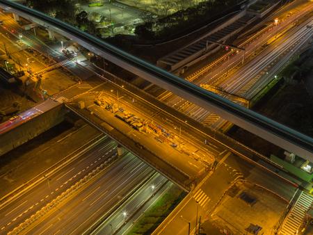 crossway: Multilevel crossroads illuminated at night in Tokyo