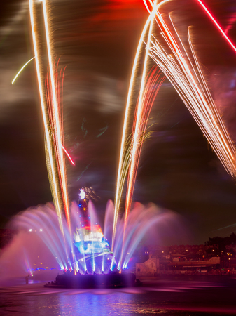 theme parks: Tokyo - January 26, 2015: Color fountain and fireworks at Disney Theme Parks See evening January 26, 2015, Tokyo, Japan
