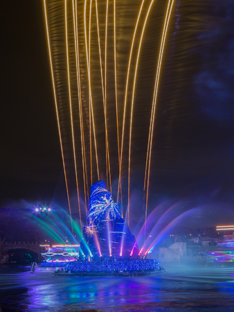 theme parks: Tokyo - January 26, 2015: Fountain and fireworks at Disney Theme Parks See evening January 26, 2015, Tokyo, Japan