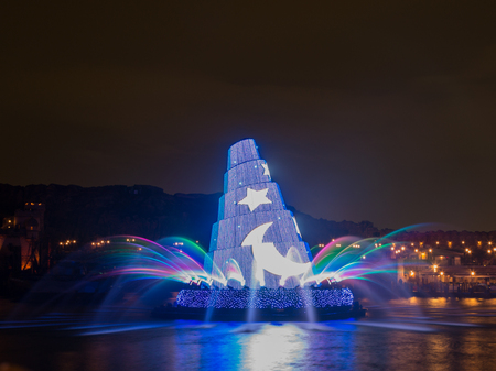 theme parks: Tokyo - January 26, 2015: Colorful fountain in the Disney Theme Parks See evening January 26, 2015, Tokyo, Japan