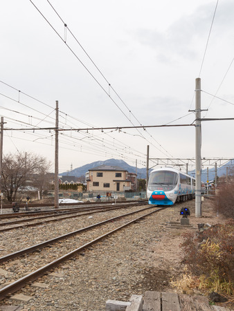 drove: Japan - January 29, 2015: A passenger train with colorful caricatures of Fuji volcano, drove up to the station January 29, 2015, Japan
