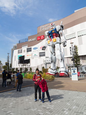 Tokyo - February 7, 2015: A giant robot at the entrance to the store and people are photographed with him Feb. 7, 2015, Odaiba, Tokyo, Japan