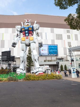 Tokyo - February 7, 2015: A giant space robots trnsformer at the entrance to the store and people are photographed with him Feb. 7, 2015, Odaiba, Tokyo, Japan