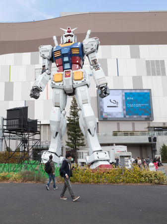 animated alien: Tokyo - February 7, 2015: A giant space robots trnsformer at the entrance to the store Feb. 7, 2015, Odaiba, Tokyo, Japan
