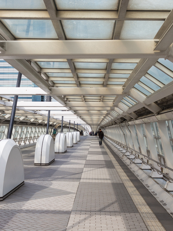 multilevel: Tokyo - February 4, 2015: Multilevel Tokyo and people go through transition glazing February 4, 2015, Tokyo, Japan Editorial