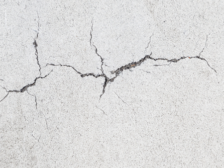 whiteness: big gray crack in white painted walls Stock Photo