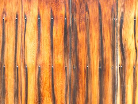 ebony: bright unusual fence exotic ebony with screws Stock Photo