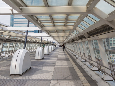 multilevel: Tokyo - February 4, 2015: Multilevel Tokyo and people go through a long transition glazing February 4, 2015, Tokyo, Japan