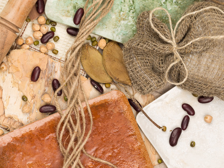 fits in: bright collage of ceramic tiles in country style in different shades, tree bark, twine and legumes on natural fabric