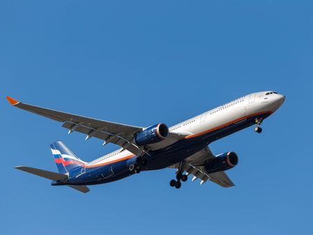 chassis: Sheremetyevo Airport -14 March 2015: Airbus A330 A. Bakoulev, Russian airline Aeroflot flies in the blue sky and puts the chassis 14 March 2015, Sheremetyevo Airport, Moscow Region, Russia Editorial