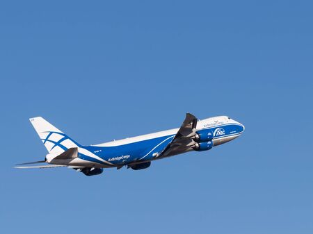 boing: Sheremetyevo Airport -14 March 2015: Boing 747-8F aircraft, AirBridgeCargo Airlines takes off into the blue sky March 14, 2015, Sheremetyevo Airport, Moscow Region, Russia Editorial