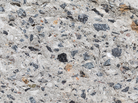 gray-brown blotches of granite gravel in concrete photo