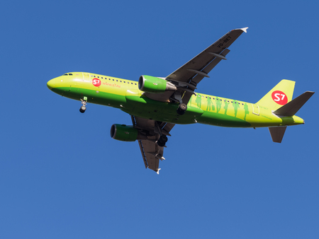 march 17: Domodedovo - March 17, 2015: Passenger Aircraft Airbus A320, Sibir S7 Airlines landing at Domodedovo airport March 17, 2015, Domodedovo, Moscow Region, Russia Editorial