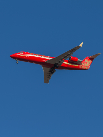 bombardier: Domodedovo - March 17, 2015: Red Passenger Aircraft Bombardier (Canadair) CRJ-200 airline Ruslayn Airlines landing at Domodedovo airport March 17, 2015, Domodedovo, Moscow Region, Russia