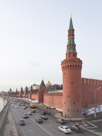 slits: Moscow - 16 January 2015: The Moscow Kremlin and the cars go on the Kremlin embankment of Moscow River January 16, 2015, Moscow, Russia Editorial
