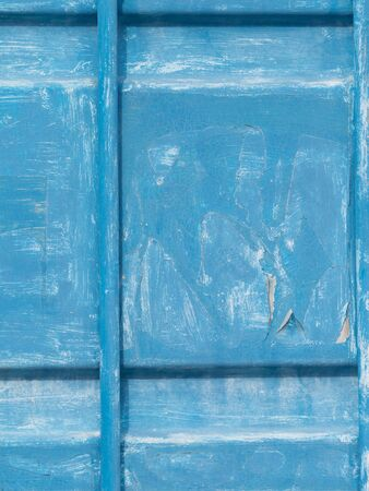 unevenly: old dirty metal gates welded from sheet metal and pipes, painted blue peeled paint with streaks