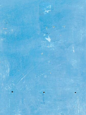 unevenly: old dirty wall, painted blue peeled paint with streaks Stock Photo