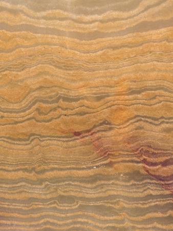 semiprecious: smooth beautiful yellow semi-precious onyx, with a variety of warm shades of brown and orange stripes