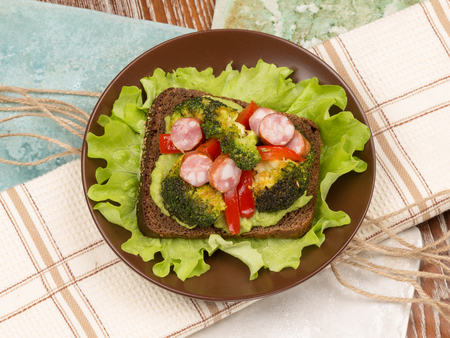 veal sausage: bright beautiful healthy nutritious delicious sandwich made of veal sausage fried broccoli and red pepper top view